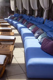 Outdoor pool patio lounge area seating Royalty Free Stock Images