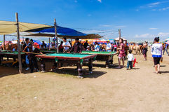 Outdoor pool tables on steppe, Nadaam horse race. NADAAM HORSE RACE OUTSIDE ULAANBAATAR, MONGOLIA - JULY 12, 2010: Outdoor pool players at Nadaam horse race, the Royalty Free Stock Photos