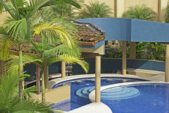 Outdoor pool in the tropics Royalty Free Stock Photography
