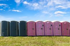 Outdoor Portable Toilets on an Open Field Royalty Free Stock Images