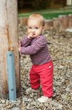 Adorable baby girl playing outside. Outdoor portrait of adorable baby girl having fun on playground, cute little 9-12 months child playing outdoors Stock Photos