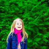 Outdoor portrait of an adorable laughing blond little girl Stock Photo