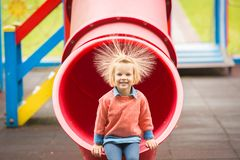 Outdoor portrait of adorable little girl playing in park Stock Photos
