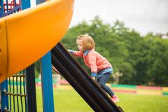 Outdoor portrait of adorable little girl playing in park Stock Images
