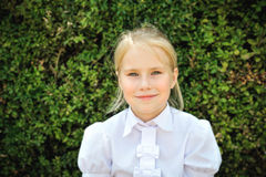 Outdoor portrait of adorable little girl. In white blouse Royalty Free Stock Photography