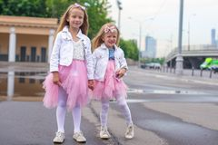 Outdoor portrait of adorable little girls in Stock Photo