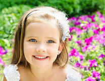 Outdoor portrait of adorable smiling little girl Royalty Free Stock Photo