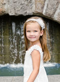 Outdoor portrait of adorable smiling little girl Stock Photo