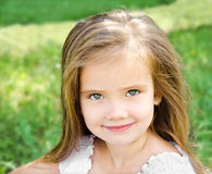 Outdoor portrait of adorable smiling little girl Stock Photos