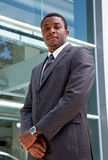 Outdoor portrait of an African business man. Dressed in a suit outside a building Royalty Free Stock Image