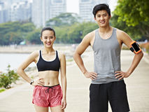 Outdoor portrait of asian exercising man and woman royalty free stock images