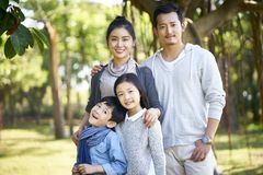 Outdoor portrait of asian family. Outdoor portrait of an asian family with two children royalty free stock images
