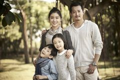 Outdoor portrait of asian family stock images