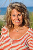 Outdoor Portrait of Attractive Middle Age Woman. Outdoor Portrait of an Attractive Middle Age Woman wearing a casual shirt Stock Photos