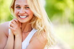 Outdoor portrait of attractive young smiling lady Royalty Free Stock Photos