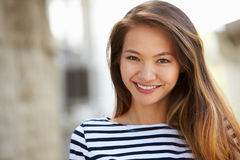 Outdoor Portrait Of Attractive Young Woman Smiling At Camera royalty free stock images