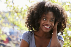 Outdoor Portrait Of Attractive Young Woman Smiling At Camera stock photography