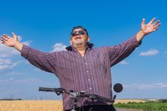 Outdoor portrait of a bearded, chubby senior man being happy Royalty Free Stock Images