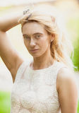 Outdoor portrait of beautiful blonde middle aged woman Stock Photos