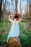 Outdoor portrait of a beautiful brunette model in blue dress in the spring forest.  Stock Images