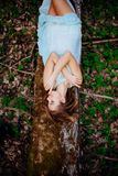 Outdoor portrait of a beautiful brunette model in blue dress in the spring forest.  Royalty Free Stock Images