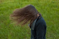 Outdoor portrait of beautiful girl laughing while the wind moves Stock Photos