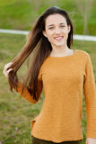 Outdoor portrait of beautiful happy teenager girl laughing. While the wind moves her hair Royalty Free Stock Photo