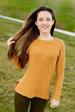 Outdoor portrait of beautiful happy teenager girl laughing. While the wind moves her hair Stock Photography