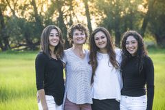 Outdoor Portrait of a beautiful Hispanic family, a mother and her daughters. Outdoor Portrait of a beautiful family, a mother and her daughters. Horizontal royalty free stock image