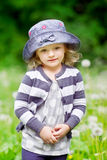 Outdoor portrait of a beautiful little girl in summer field Royalty Free Stock Photo