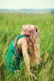 Portrait of a beautiful middle aged blonde woman in field. Outdoor portrait of a beautiful middle aged blonde woman in field stock photos