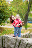 Outdoor portrait of beautiful mother and daughter Stock Photography