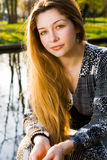 Outdoor portrait of beautiful serene young woman Royalty Free Stock Images