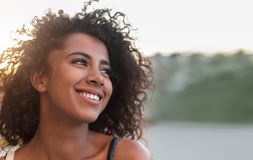 Outdoor portrait of smiling african american girl stock photography
