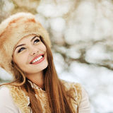 Outdoor portrait of beautiful smiling girl looking at copy space Stock Photography