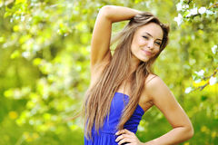 Outdoor portrait of beautiful smiling girl near a copy space Royalty Free Stock Photo