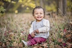 Outdoor Portrait of a beautiful smiling mixed race little boy stock photo