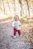 Outdoor Portrait of a beautiful smiling mixed race little boy walking royalty free stock image
