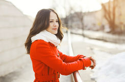 Outdoor portrait of beautiful woman dressed a red jacket Royalty Free Stock Image