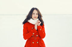 Outdoor portrait of beautiful woman dressed a red jacket Royalty Free Stock Images