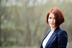 Outdoor portrait of beautiful woman with red hair Royalty Free Stock Photo