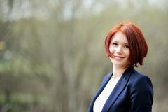 Outdoor portrait of beautiful woman with red hair Stock Photography