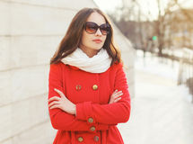 Outdoor portrait of beautiful woman in sunglasses and red jacket Stock Photography