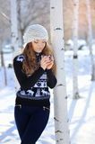 Outdoor portrait of beautiful woman in winter holding a cup Royalty Free Stock Photos