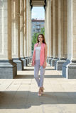 Outdoor portrait of beautiful young woman near column stock photography