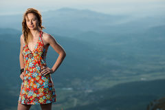 Outdoor portrait of beautiful young woman in short summer dress Stock Photography