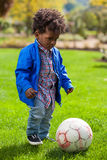 Outdoor portrait of a black baby playing soccer. Outdoor portrait of a cute  black baby playing soccer Stock Image