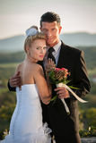 Outdoor portrait of bride and groom on wedding day Stock Image