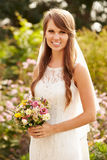 Outdoor Portrait Of Bride Holding Bouquet On Wedding Day Royalty Free Stock Photography