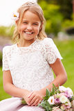 Outdoor Portrait Of Bridesmaid Holding Bouquet Royalty Free Stock Images